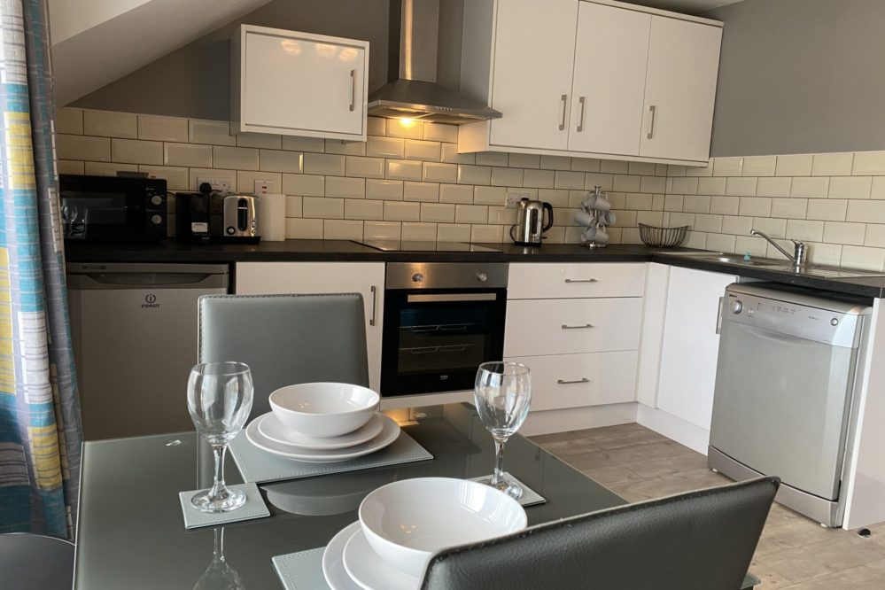 The Kitchen in VIP Church Loft Apartment is fully equipped with everything you need for a great stay!